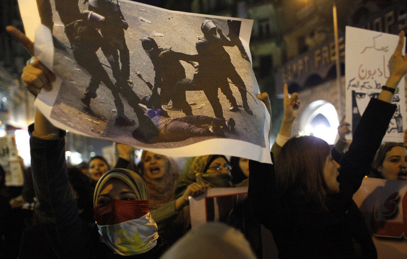 Egyptian Security Forces Beat Women.jpg